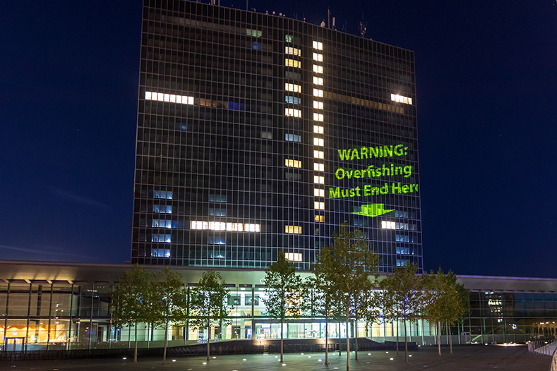 Projection against overfishing on the European Convention Centre, ahead of the AGRIFISH EU Council meeting of fisheries ministers, Luxembourg, 13 October 2019. Non-governmental organisations have called for an end to overfishing in EU waters, in line with EU member state commitments to follow the law and fish within scientific limits by 2020.