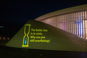 The Baltic Sea is in Crisis. Why are you still overfishing? Light projection outside Agrifish meeting.